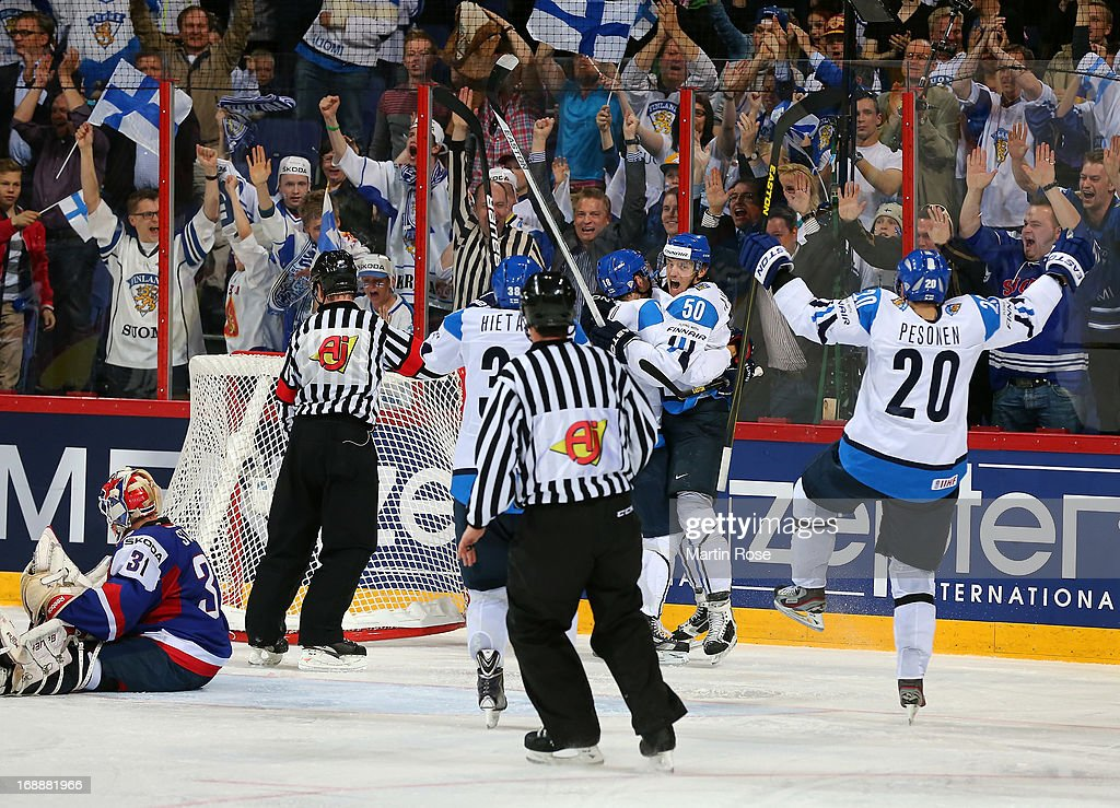 Juhamatti Aaltonen (#50) of Finland celebrates after he scores his team's winning goal during the IIHF World Championship quarterfinal match between Finland and Slovakia at Hartwall Areena on May 16, 2013 in Helsinki, Finland.