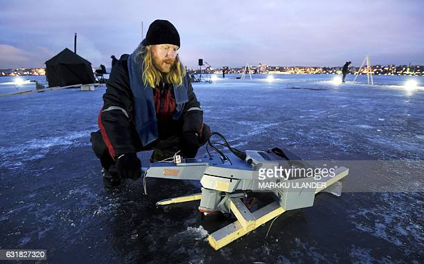 JuhaMatti Pesonen shows the 1000w electronic outboard motor which rolls the ice carousel with the other same kind of engine on the...