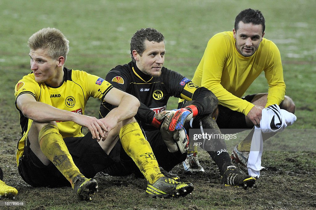 Juhani Ojala (L), goalkeeper and captain Marco Wolfli (C) and Raphael Nuzzolo react at the end of the Europa League group A football match between BSC Young Boys and FC Anji Makhachkala on Decenber 6, 2012, in Bern. Despite winning the match the YoungBoys did not qualify for the next round of the Europa League championship.