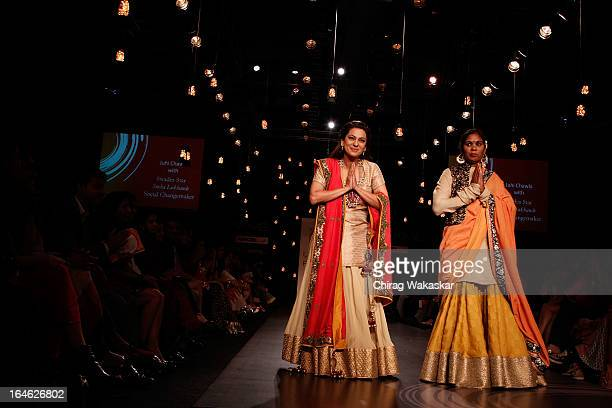 Juhi Chawla Sneha Lokhande showcase designs by Vikram Phadnis on the runway during day four of Lakme Fashion Week Summer/Resort 2013 on March 25 2013...