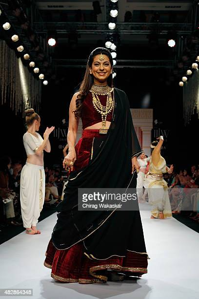 Juhi Chawla walks the runway at the Tanishq show during Day 1 of the India International Jewellery Week at the Grand Hyatt on August 3 2015 in Mumbai...