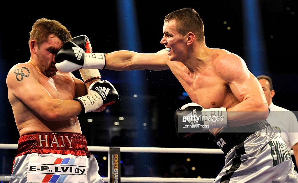 Juho Haapoja (L) of Finland and Mateusz Masternak of Poland exchange punches during the EBU European Championship Cruiser Weight title fight at Arena Nurnberger on December 15, 2012 in Nuremberg, Germany.