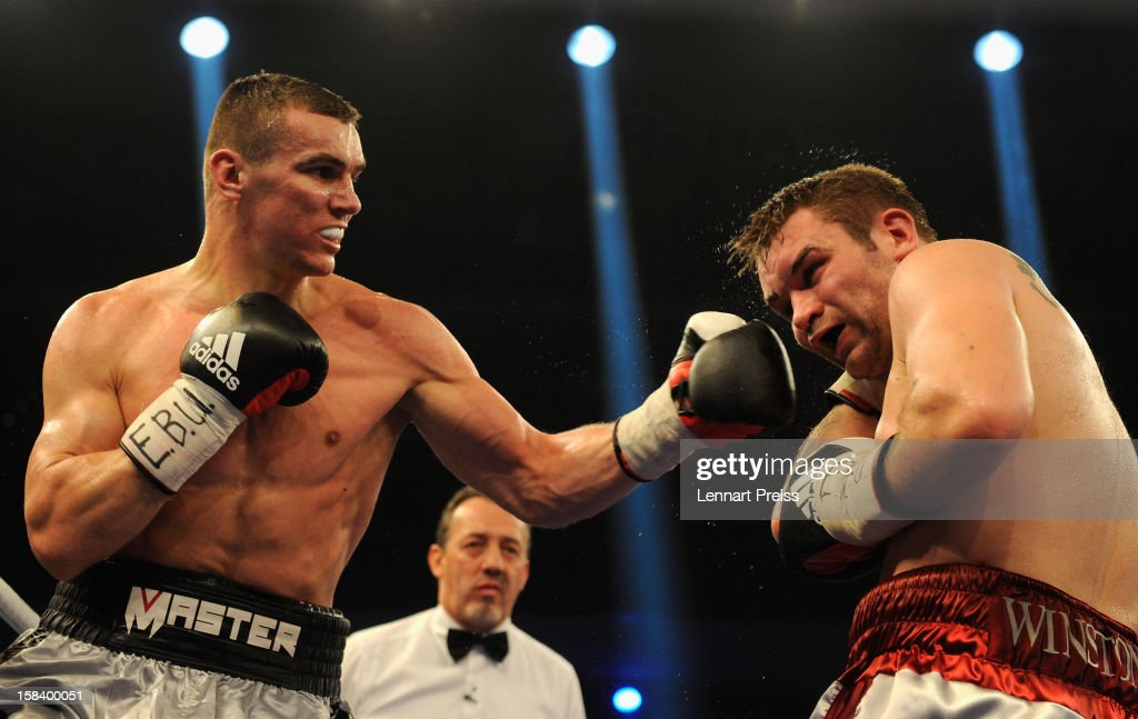 Juho Haapoja (R) of Finland and Mateusz Masternak of Poland exchange punches during the EBU European Championship Cruiser Weight title fight at Arena Nurnberger on December 15, 2012 in Nuremberg, Germany.