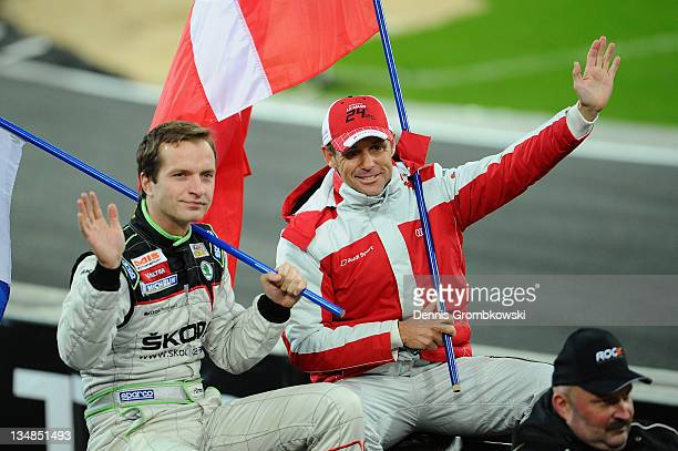 Juho Haenninen and Tom Kristensen enter the race track during day one of the race of champions event at the Esprit Arena on December 3 2011 in...