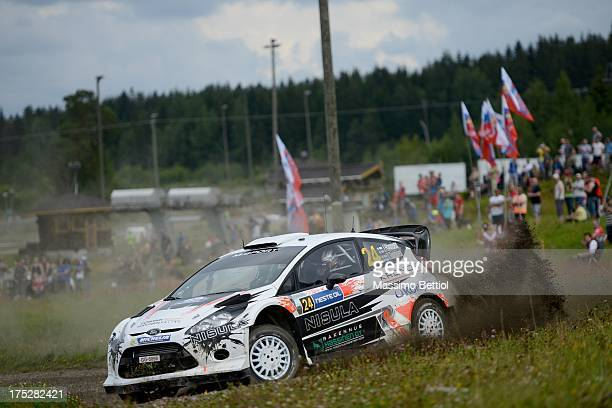 Juho Hanninen of Finland and Tomi Tuominen of Finland compete in their Ford Fiesta RS WRC during Day One of the WRC Finland on August 1 2013 in...