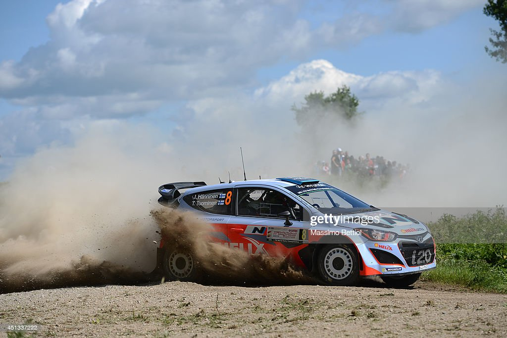 Juho Hanninen of Finland and Tomi Tuominen of Finland compete in their Hyundai Motorsport Hyundai i20 WRC during Day One of the WRC Poland on June 27, 2014 in Mikolajki, Poland.