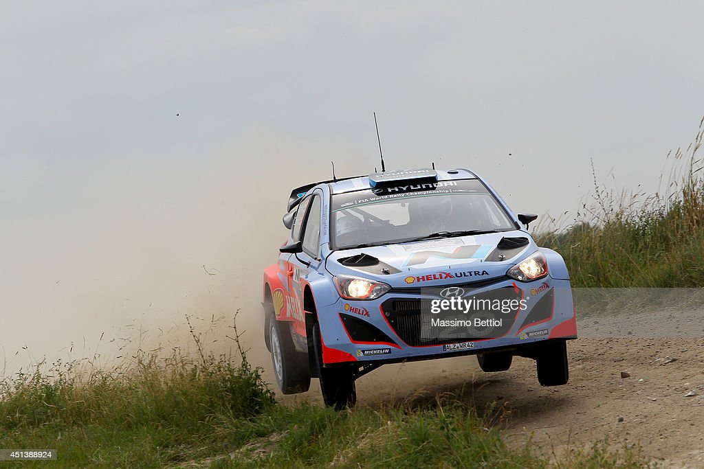 Juho Hanninen of Finland and Tomi Tuominen of Finland compete in their Hyundai Motorsport Hyundai i20 WRC during Day Two of the WRC Poland on June 28, 2014 in Mikolajki, Poland.