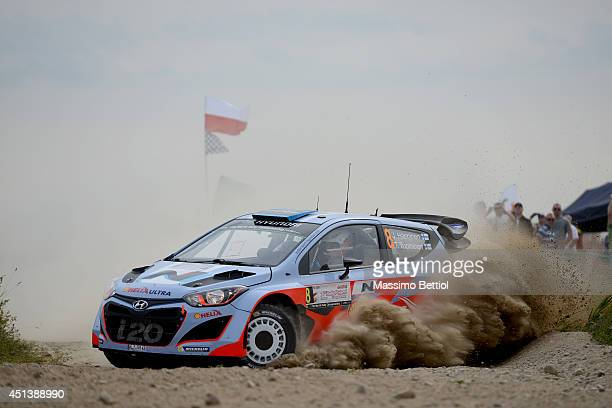 Juho Hanninen of Finland and Tomi Tuominen of Finland compete in their Hyundai Motorsport Hyundai i20 WRC during Day Two of the WRC Poland on June 28...