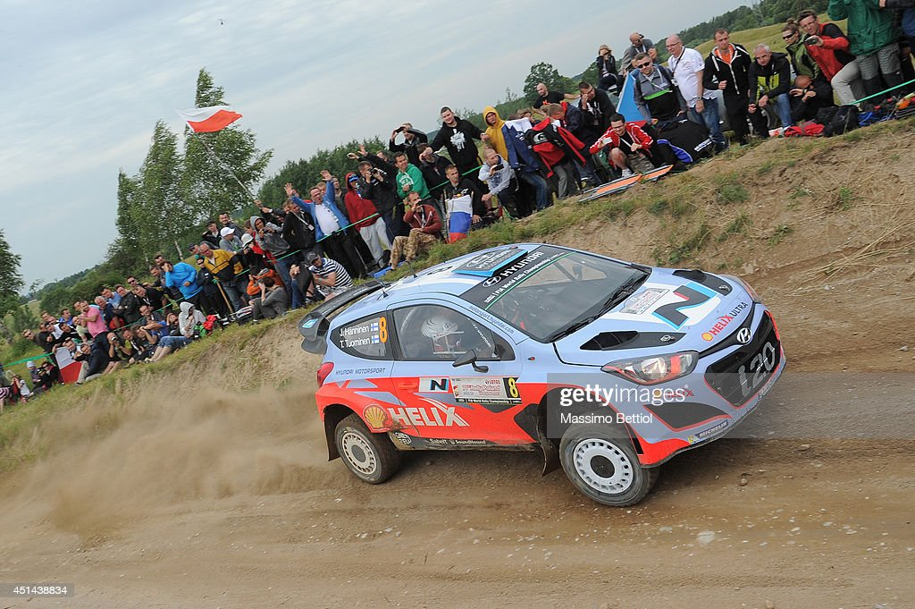 Juho Hanninen of Finland and Tomi Tuominen of Finland compete in their Hyundai Motorsport Hyundai i20 WRC during Day Three of the WRC Poland on June 29, 2014 in Mikolajki, Poland.