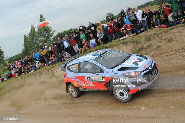 Juho Hanninen of Finland and Tomi Tuominen of Finland compete in their Hyundai Motorsport Hyundai i20 WRC during Day Three of the WRC Poland on June...