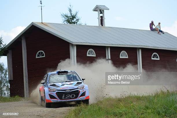 Juho Hanninen of Finland and Tomi Tuominen of Finland compete in their Hyundai Motorsport Hyundai I20 WRC during Day Two of the WRC Finland on August...