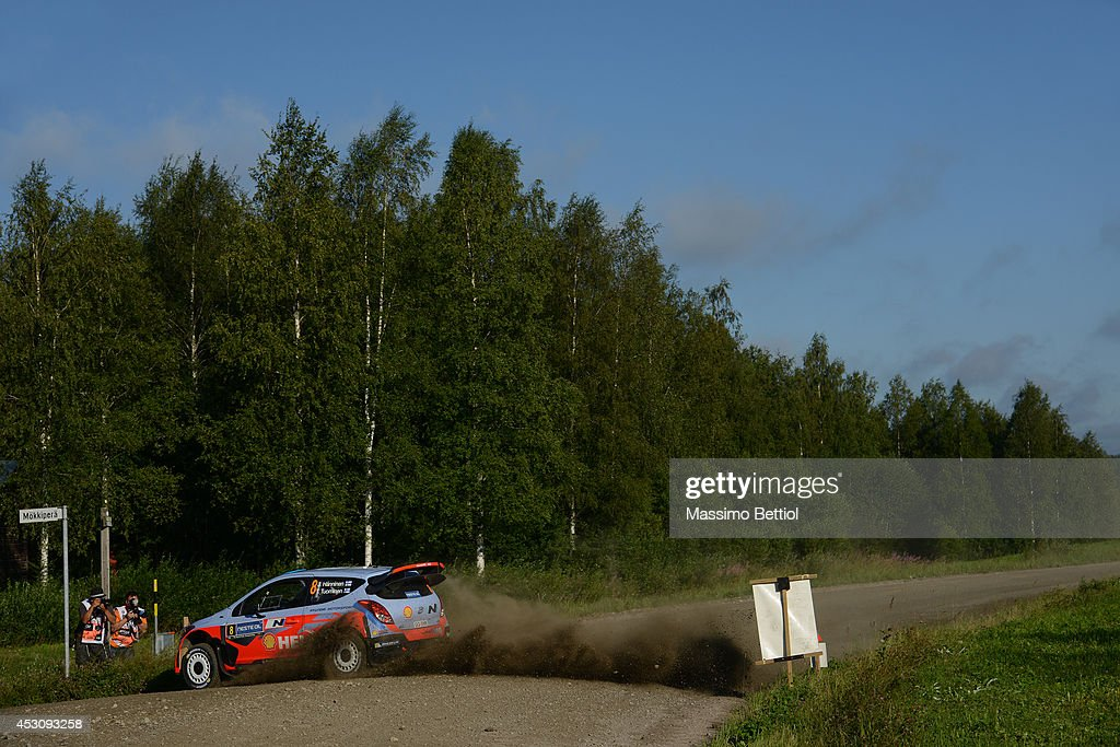 Juho Hanninen of Finland and Tomi Tuominen of Finland compete in their Hyundai Motorsport Hyundai I20 WRC during Day Two of the WRC Finland on August 2, 2014 in Jyvaskyla, Finland.
