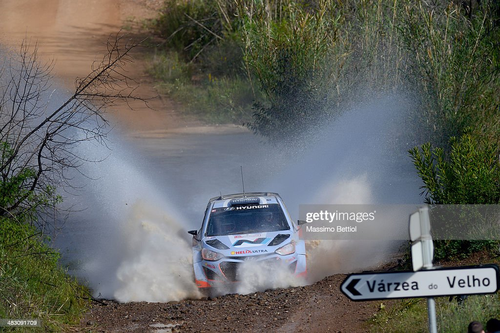 Juho Hanninen of Finland and Tomi Tuominen of Finland compete in their Hyundai Motorsport Hyundai ì20 WRC during Day Three of the WRC Portugal on April 6, 2014 in Faro, Portugal.
