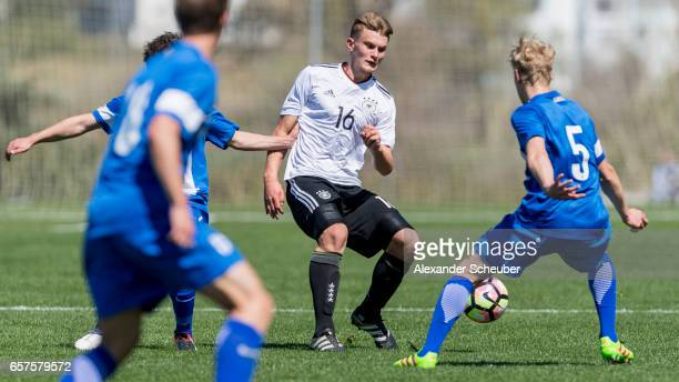 Juho Hyvaerinen of Finland challenges Lars Lukas Mai of Germany during the UEFA U17 elite round match between Germany and Finland on March 25 2017 in...