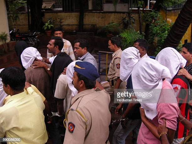 Juhu police officers with 9 robbers they caught near Holiday Inn Hotel Juhu These robbers came for robbery at Citibank Juhu branch on Thursday