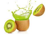 juice exploding out of a kiwi fruit isolated on white