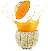 juice spilling out of a cantaloupe melon isolated on white