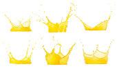 juice splashes set isolated on white. Clipping path. Splashing orange juice collection