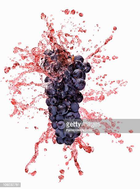 Juice splashing on red grapes