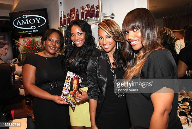 Juicy Editor in Chief Paula Renfroe TV personality Yandy Smith singer/TV personality Olivia and owner Amoy Pitters attend Amoy Couture Hair Holiday...
