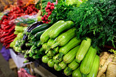 Juicy greens of zucchini, dill, parsley and eggplant, radish, beet and other vegetables for sale in the market