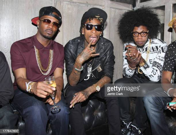 Juicy J Wiz Khalifa and Trinidad James attend the Hennessy VS VMA Celebration at Avenue on August 24 2013 in New York City