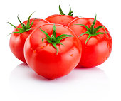 Juicy ripe red tomatoes isolated on a white background