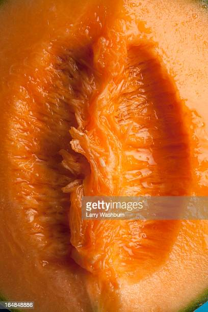A juicy slice of cantaloupe that is suggestive of female genitalia