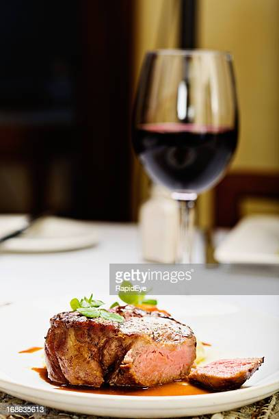Juicy steak with glass of red wine; the perfect meal
