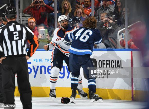 Jujhar Khaira of the Edmonton Oilers fights with JC Lipon of the Winnipeg Jets on September 23 2017 at Rogers Place in Edmonton Alberta Canada