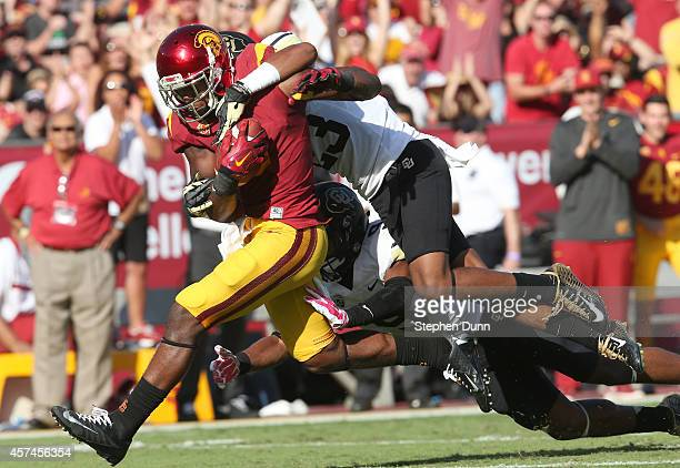 JuJu Smith of the USC Trojans carrries the ball after a reception as defensive back Ahkello Witherspoon of the Colorado Buffaloes hangs on at Los...