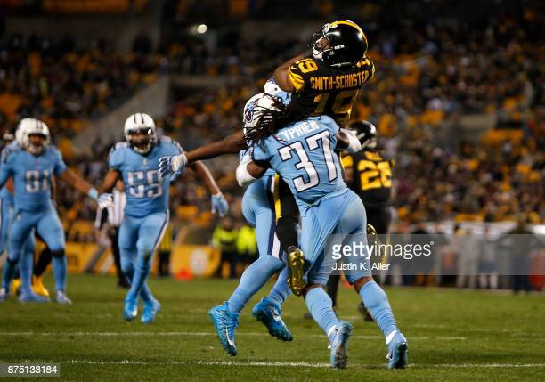 JuJu SmithSchuster of the Pittsburgh Steelers is hit by Johnathan Cyprien of the Tennessee Titans after making a catch in the second half during the...