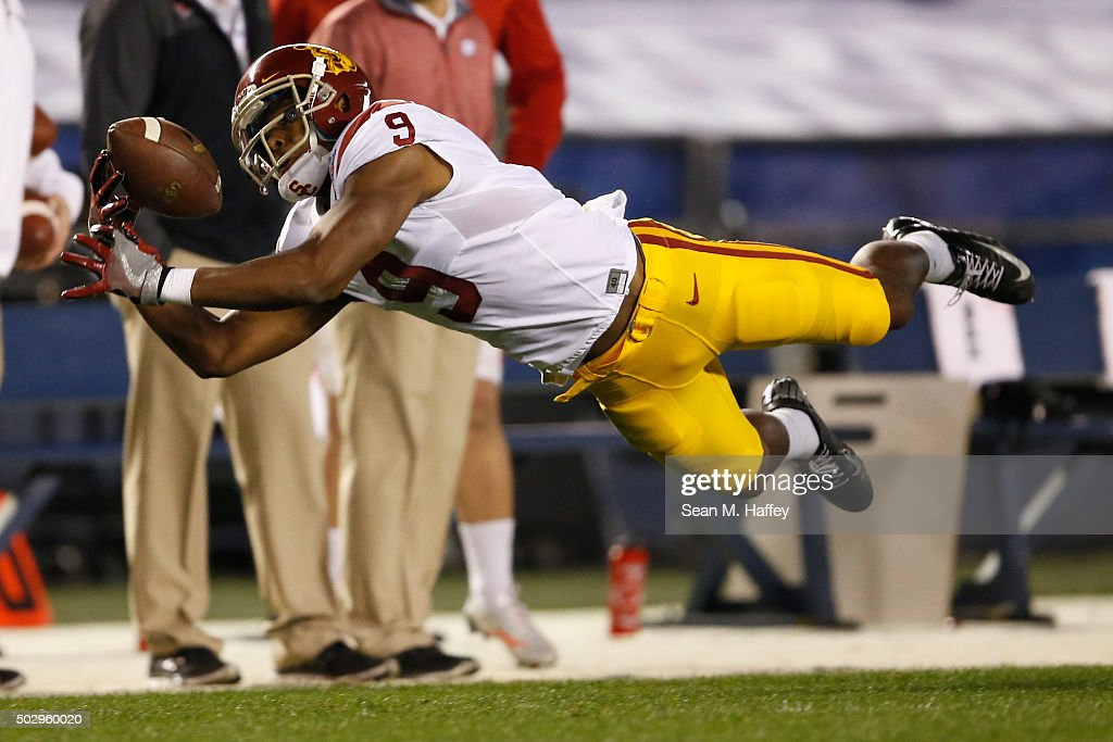 JuJu Smith-Schuster #9 of the USC Trojans can't control this pass during the first quarter of a game against the Wisconsin Badgers during the National University Holiday Bowl at Qualcomm Stadium on December 30, 2015 in San Diego, California.