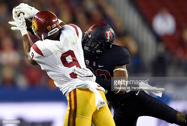 JuJu SmithSchuster of the USC Trojans catches a pass over Alameen Murphy of the Stanford Cardinal during the second quarter of the NCAA Pac12...