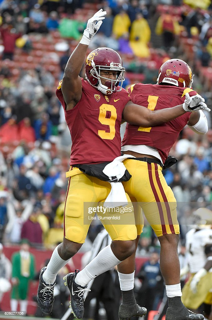 JuJu Smith-Schuster #9 of the USC Trojans celebrates with teammate Darreus Rogers #1 after scoring a touchdown in the fourth quarter against the Notre Dame Fighting Irish at Los Angeles Memorial Coliseum on November 26, 2016 in Los Angeles, California.