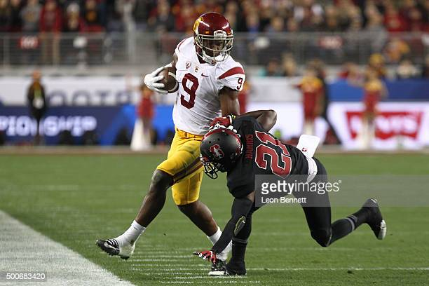 JuJu SmithSchuster of the USC Trojans fights of being tacked by Ronnie Harris of the Stanford Cardinal during a 4122 Stanford win at the PAC12...