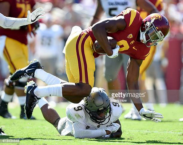 JuJu SmithSchuster of the USC Trojans is tackled after his catch by Tedric Thompson of the Colorado Buffaloes during the second quarter at Los...