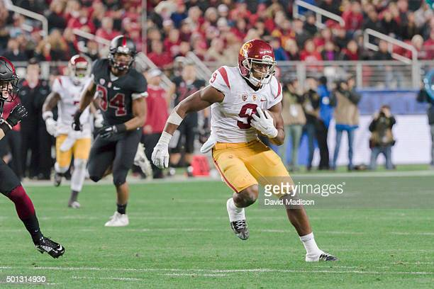 JuJu SmithSchuster of the USC Trojans runs after a pass reception during the Pac12 Championship Game against the Stanford Cardinal played on December...