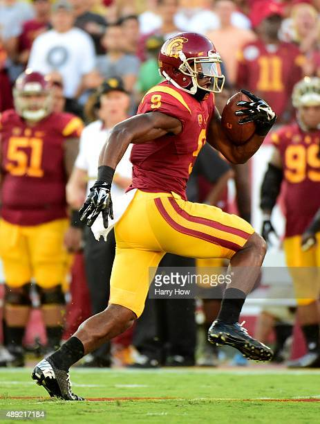 JuJu SmithSchuster of the USC Trojans runs after his catch to score a touchodwn to take a 2110 lead over the Stanford Cardinal during the second...