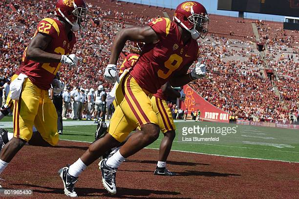 JuJu SmithSchuster of the USC Trojans scores a touchdown in the 1st quarter against the Utah State Aggies at Los Angeles Coliseum on September 10...