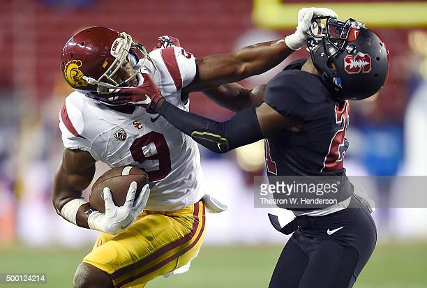 JuJu SmithSchuster of the USC Trojans stiff arms Ronnie Harris of the Stanford Cardinal during the second quarter of the NCAA Pac12 Championship game...