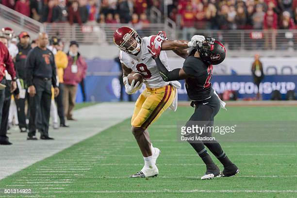 JuJu SmithSchuster of the USC Trojans stiff arms Ronnie Harris of the Stanford Cardinal during the Pac12 Championship Game played on December 5 2015...