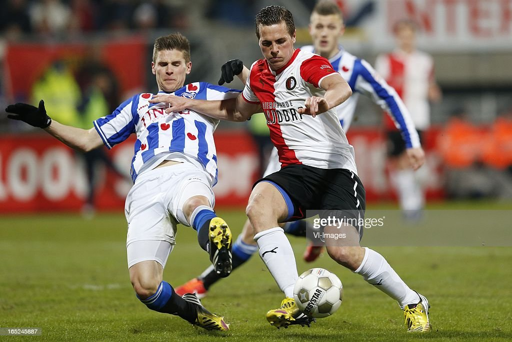 Jukka Raitala of Heerenveen,Wesley Verhoek of Feyenoord during the Dutch Eredivisie match between SC Heerenveen and Feyenoord at the Abe Lenstra Stadium on march 30, 2013 in Heerenveen, The Netherlands