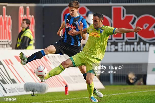 Jukka Raitala of Paderborn and Mahir Saglik of Bochum fight for the ball during the Second Bundesliga match between SC Paderborn and VfL Bochum at...