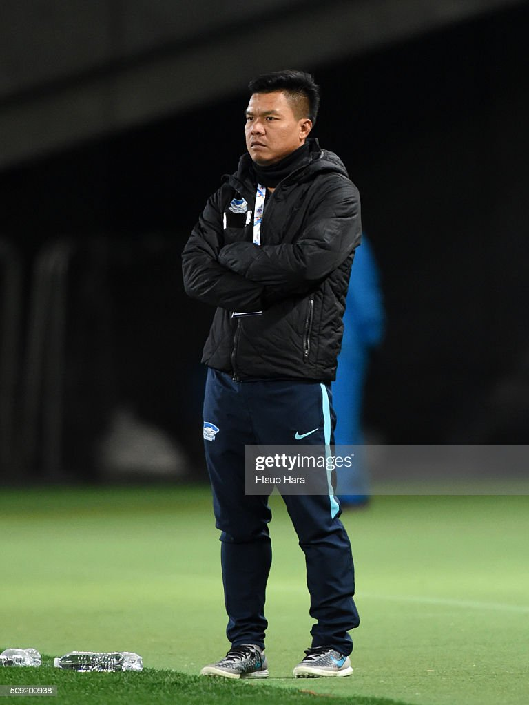 Jukkapant Punpee,coach of Chonburi FC looks on during the AFC Champions League playoff round match between FC Tokyo and Chonburi FC at the Tokyo Stadium on February 9, 2016 in Chofu, Japan.