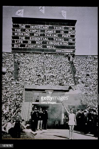 The Olympic Torch is presented at the 1948 Summer Olympic Games at Wembley Stadium in London England Mandatory Credit Allsport/Allsport