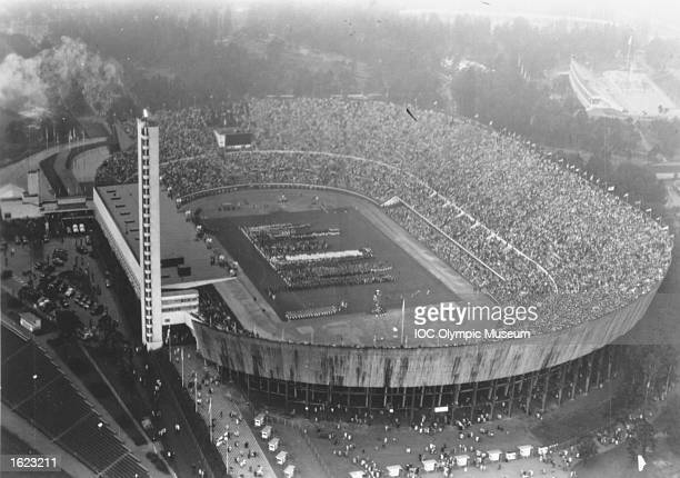 Aerial view of the Olympic Stadium during the Opening Ceremony of the 1952 Olympic Games in Helsinki Finland Mandatory Credit IOC Olympic Museum...