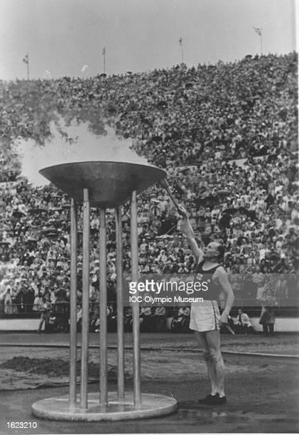 Paavo Nurmi of Finland lights the Olympic Flame during the Opening Ceremony of the 1952 Olympic Games in Helsinki Finland Mandatory Credit IOC...