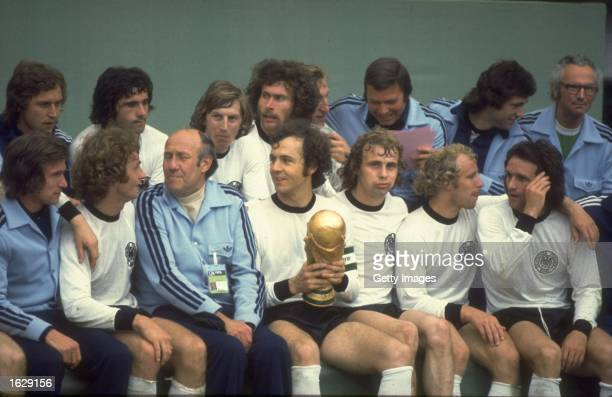 A group photograph of Franz Beckenbauer and the West German team with the trophy after the World Cup final against Holland at the Olympiastadion in...