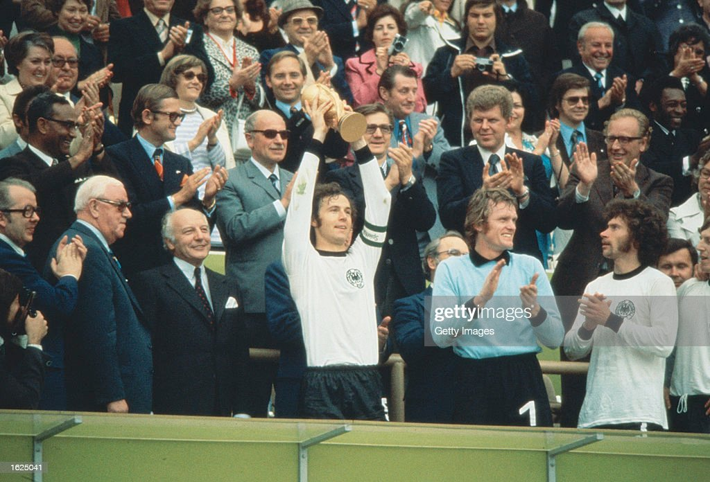 <a gi-track='captionPersonalityLinkClicked' href=/galleries/search?phrase=Franz+Beckenbauer&family=editorial&specificpeople=210545 ng-click='$event.stopPropagation()'>Franz Beckenbauer</a> (centre) of Germany becomes the first Captain to lift the new FIFA trophy after leading his side to victory over Holland in the World Cup Final at the Olympic Stadium in Munich, Germany. Germany won the match 2-1. \ Mandatory Credit: Allsport UK /Allsport